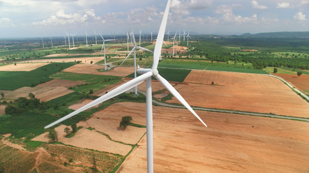 Aerial view of wind turbines in blue sky