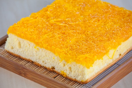 gum paste: Thai Cake sweetmeat made of egg yolk on wooden table.