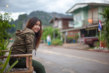 travel woman: Portrait of beautiful asian young woman near the road