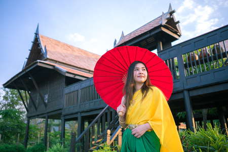 thai culture: Thai woman dressing with  umbrella traditional style