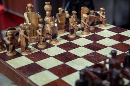 vintage wood chess pieces on board game