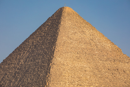 cheops: The Great pyramid with blue sky in Giza, Egypt