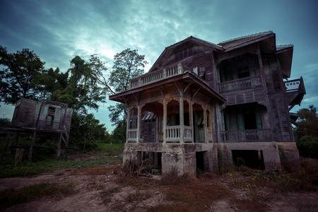 abandoned old wood house on twilight Stock Photo