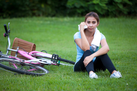 Happy Young Woman riding bicycle outside. Healthy Lifestyle. photo