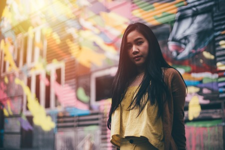 Portrait of young pretty hipster asian woman