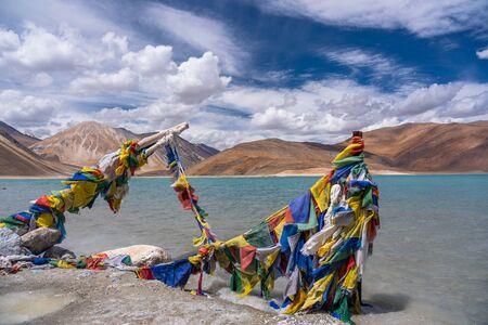Colourful prayer flags in front of Pangong Lake, Leh, Ladakh, India