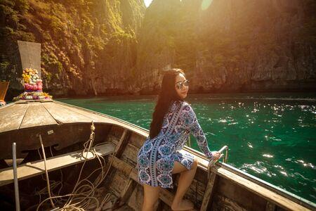 Young asian woman posting on the Maya bay,Phi-phi Island Krabi, Thailand