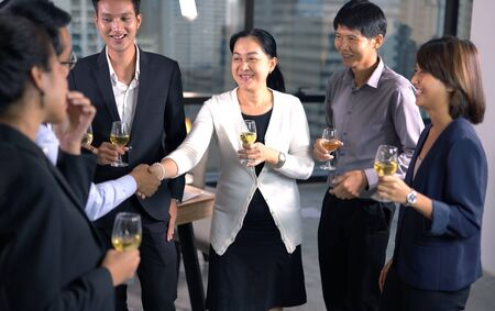 Group of business poeple with glasses of whiskey