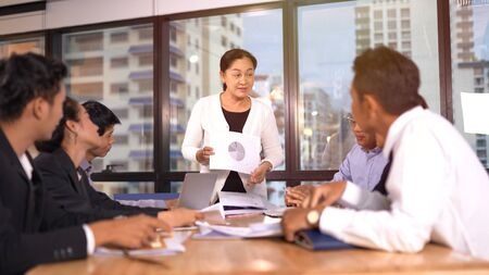 Businesspeople discussing together in conference room 版權商用圖片