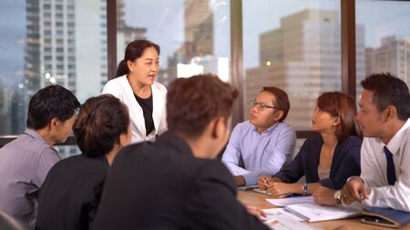 Businesspeople discussing together in conference room 版權商用圖片 - 134715429