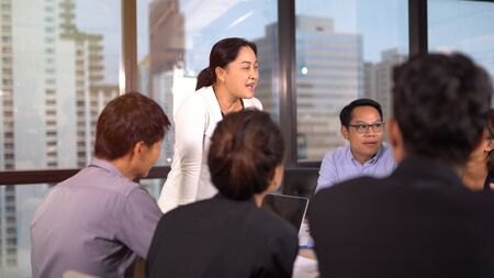 Businesspeople discussing together in conference room 版權商用圖片 - 134715431