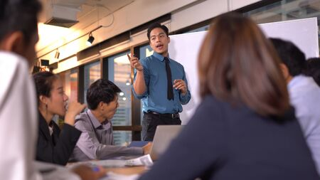 Businesspeople discussing together in conference room 版權商用圖片 - 134715440
