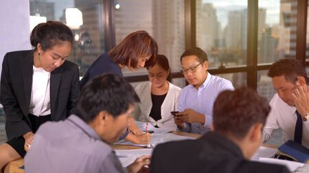 Businesspeople discussing together in conference room 版權商用圖片 - 134715457