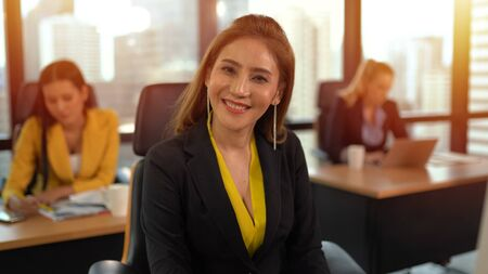 Asian business woman smiling on workplace