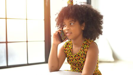 Cute african american girl talking on a mobile phone.