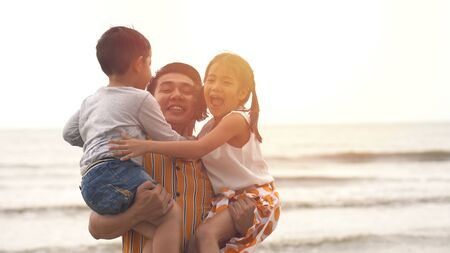 Happiness Father and son and daughter playing on the beach