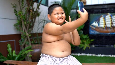 Asian child Boy salfie and playing mobile phones 版權商用圖片