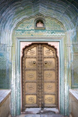 Colorful gate door in pink city at City Palace of Jaipur, Rajasthan, India 版權商用圖片