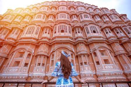 Young Woman during Sunset at Hawa Mahal, Jaipur,Rajasthan, India Editorial