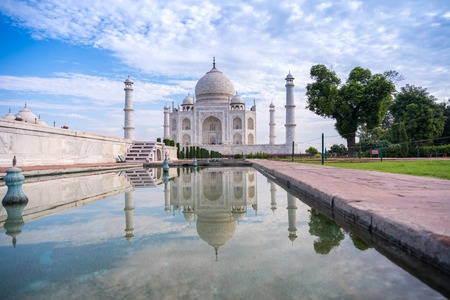 The morning view of Taj Mahal monument reflecting in water of the pool, Agra, India
