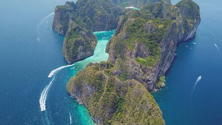 Aerial drone view of tropical turquoise water Maya Bay and limestone cliffs, Phi Phi islands, Thailand