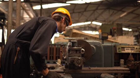 Service man engineer working at manufacturing factory