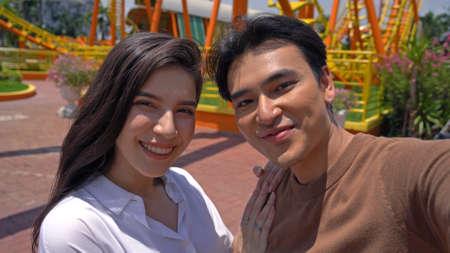 Asian Couple Dating selfie Fun Park Enjoyment Amusement