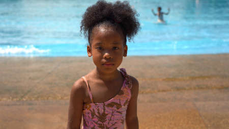 Portrait of African kid having fun on vacation at a water park 스톡 콘텐츠