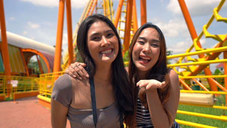 Asian friends having fun at the amusement park