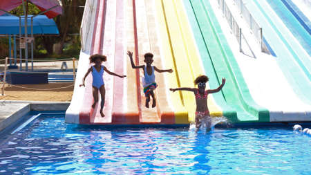 African kid having fun on vacation at a water park