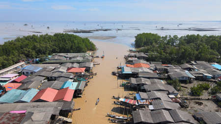 Aerial view of fisherman village, and river to the sea in Surat Thani, Thailand 스톡 콘텐츠