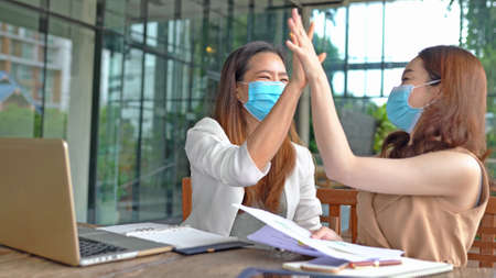 Business asian workers wear masks to protect and take care of their health