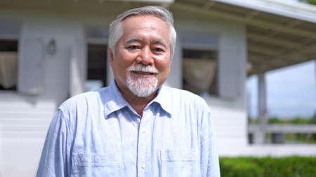Portrait of asian senior man smiling and loooking at camera
