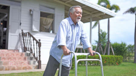 Portrait of a asian mature gentleman using a walker at home 스톡 콘텐츠