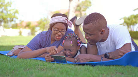 Portrait of an African American family looking very happy outdoors 版權商用圖片