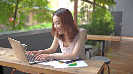 Asian woman working from home during Coronavirus or Covid-19 quarantine