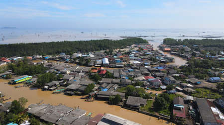 Aerial view of fisherman village, and river to the sea in Surat Thani, Thailand 에디토리얼