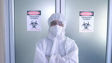 Portrait of Asian doctor wearing ppe suit and face mask in hospital. Corona virus, Covid-19