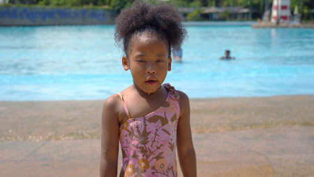 Portrait of African kid having fun on vacation at a water park Standard-Bild