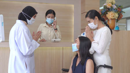 Asian Doctor and patient health care medical check sickness at hospital