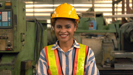 Portrait of an industrial woman engineer posing in a factory