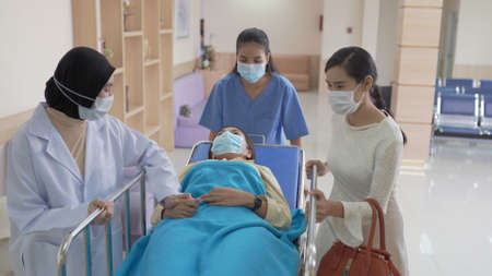 Nurse and doctor in a hurry taking patient to operation theatre