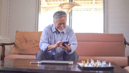 Asian Senior Man Mobile Phone Communication Connection Technology Concept