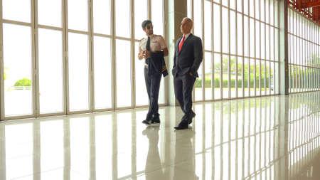 Pilot and boss talking at the airport terminal