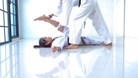 Teacher teaching taekwondo girl, Korean martial art