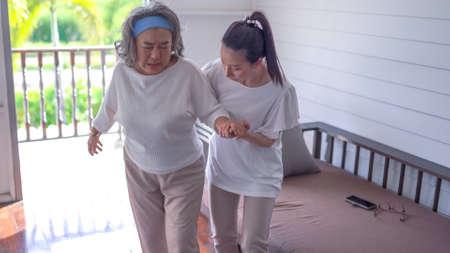 Senior asian woman with her home caregiver Standard-Bild