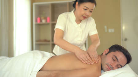 Young caucasian man relax during massage on back