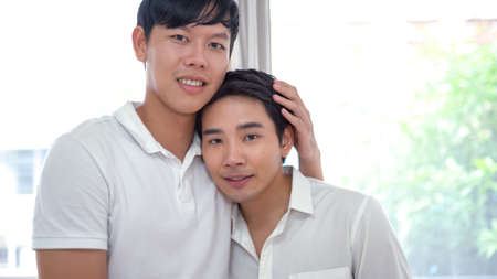 Asian gay couple happy together at home