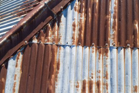 A rusty corrugated iron roof in poor condition