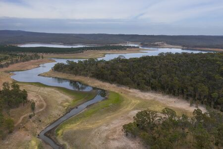 Aerial view of a fresh water reservoir in rural Australia which is reducing due to the extreme drought